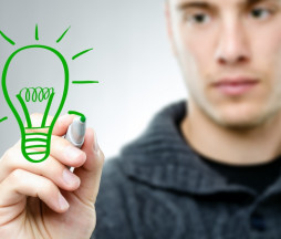 Man draws a green bulb - renewable energy concept