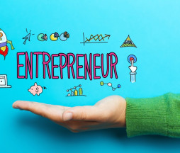 Entrepreneur with hand on blue background